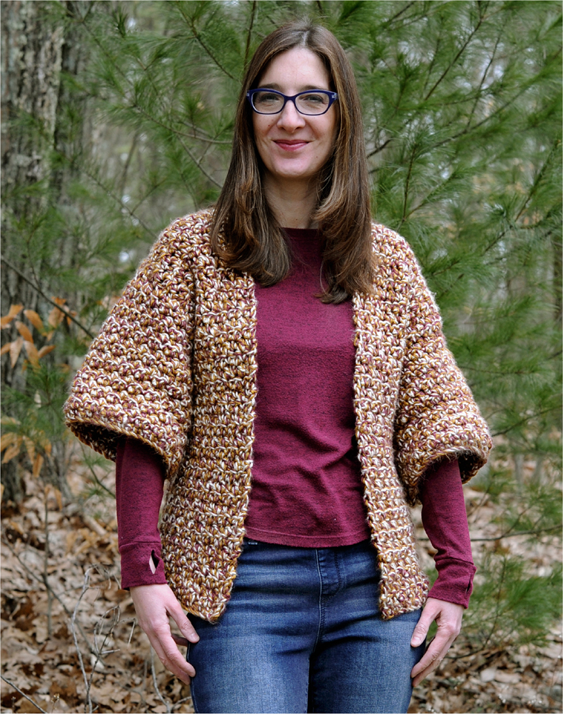 Front of woman wearing a crochet cardigan