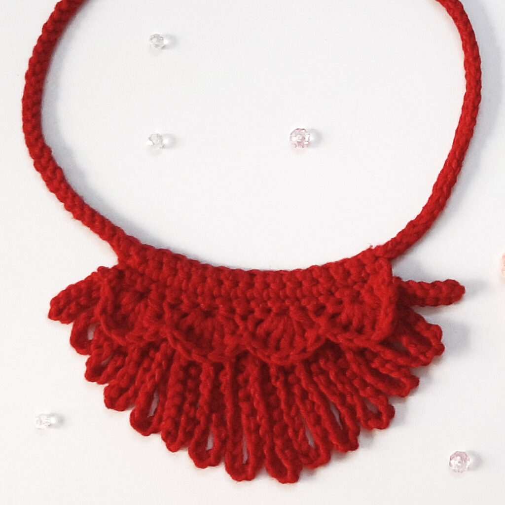 The Loopy Crochet Necklace in one color.  This pattern can be customized for any outfit, holiday, or personality.