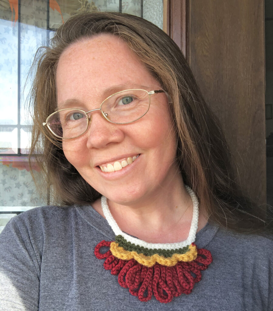 Michelle is cute wearing her autumn inspired crochet jewelry.