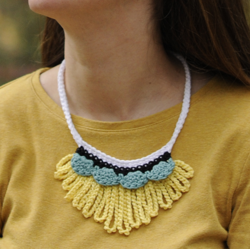 Add excitement to your wardrobe with the Loopy Worsted Necklace by Crochet with Mary Beth.