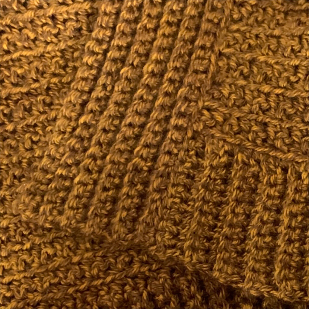 Close-up of ribbing on the edge of a crochet cardigan.