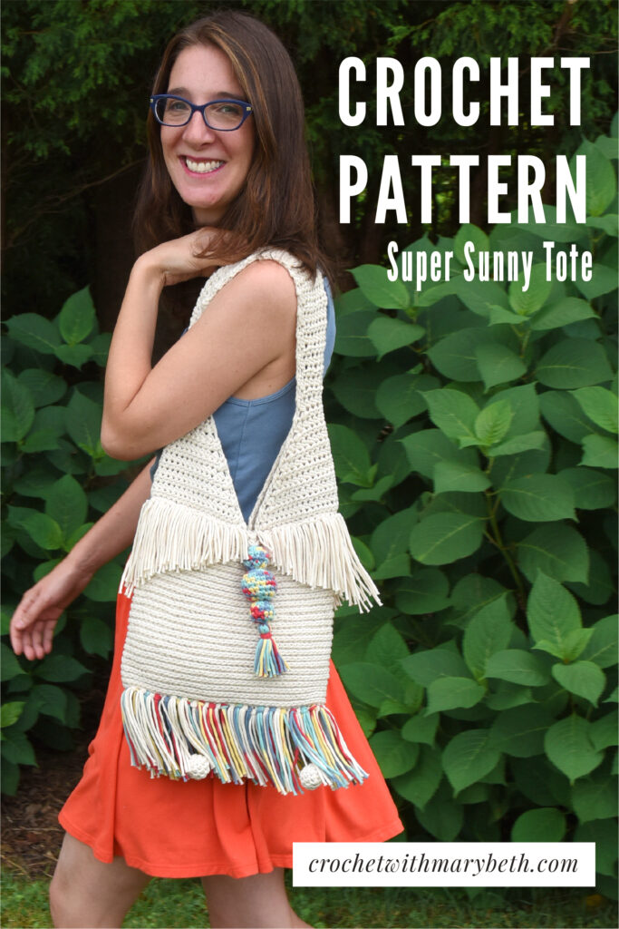 The Super Sunny Crochet Tote pattern's beautiful stitch, funky tassels, shaped fringe, and decorative balls will bring you sunshine on even the cloudiest of days.