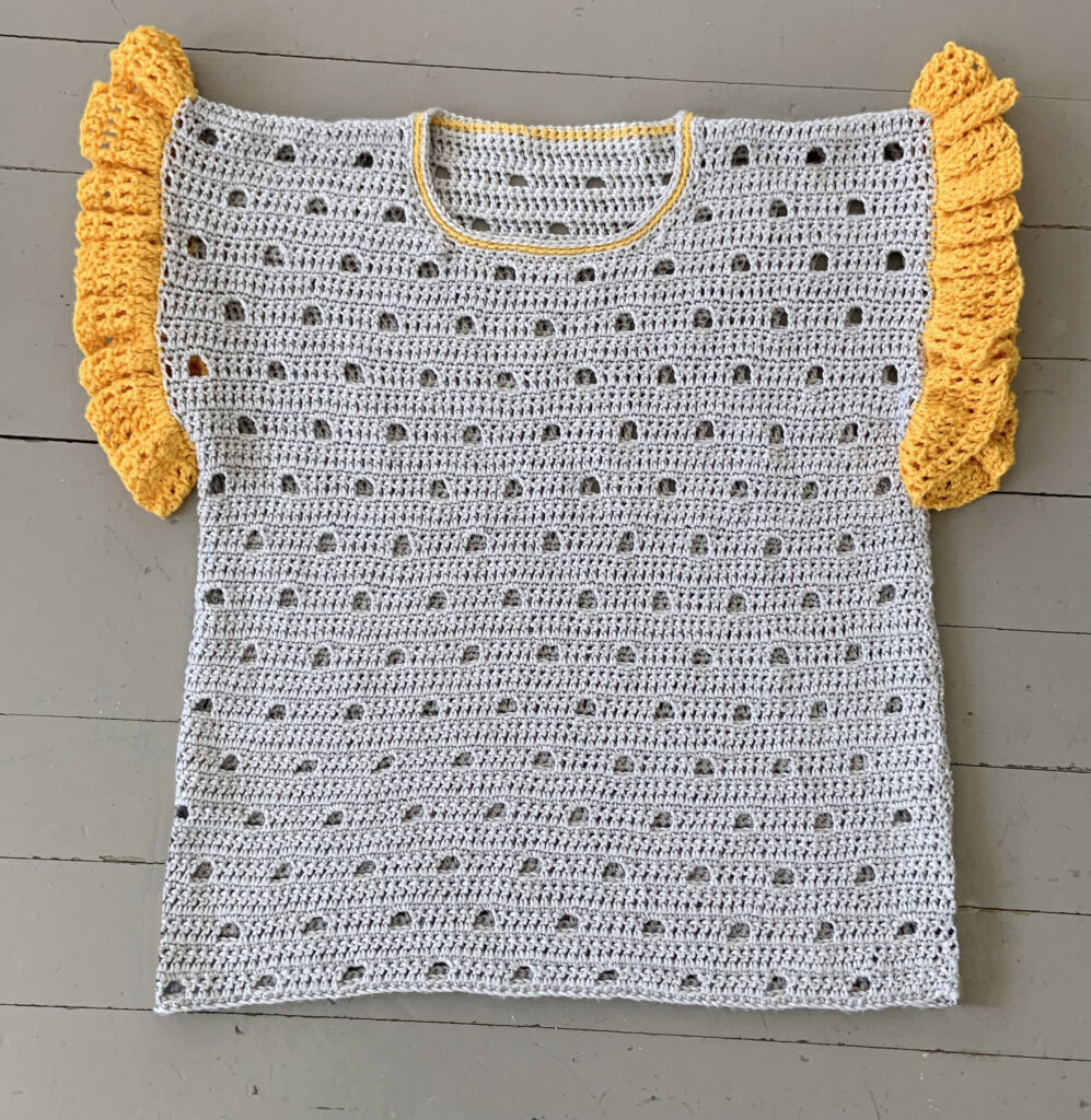 The light airy stitch makes this crochet tee cool and comfortable to wear in warm weather.