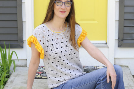 A woman wearing the Be Spotted Crochet Tee. A garment by Mary Beth Cryan