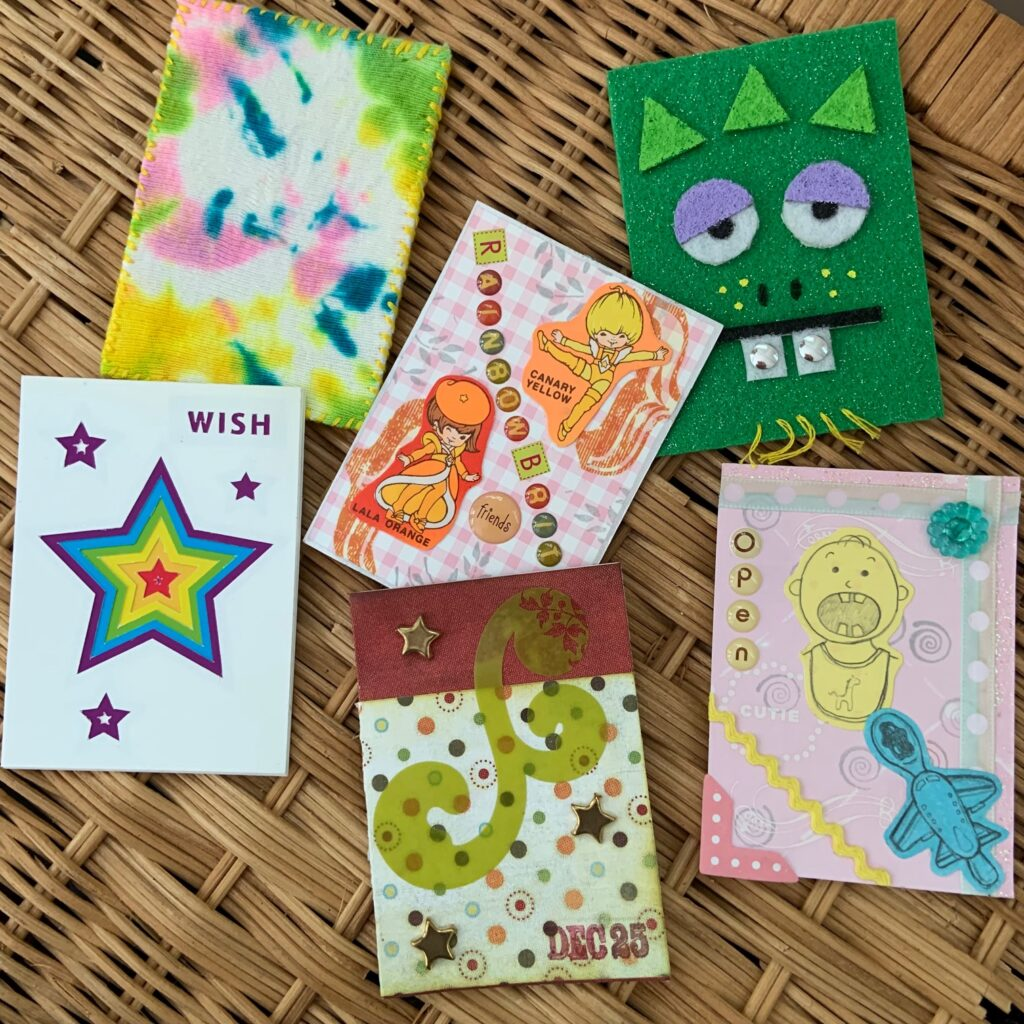 """Artist trading cards made by Mary Beth Cryan cut using her """"don't look too close"""" method."""