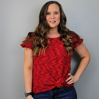 Michelle Ferguson of Two Brothers Blankers wearing a red, knotted, modest crochet top pattern.