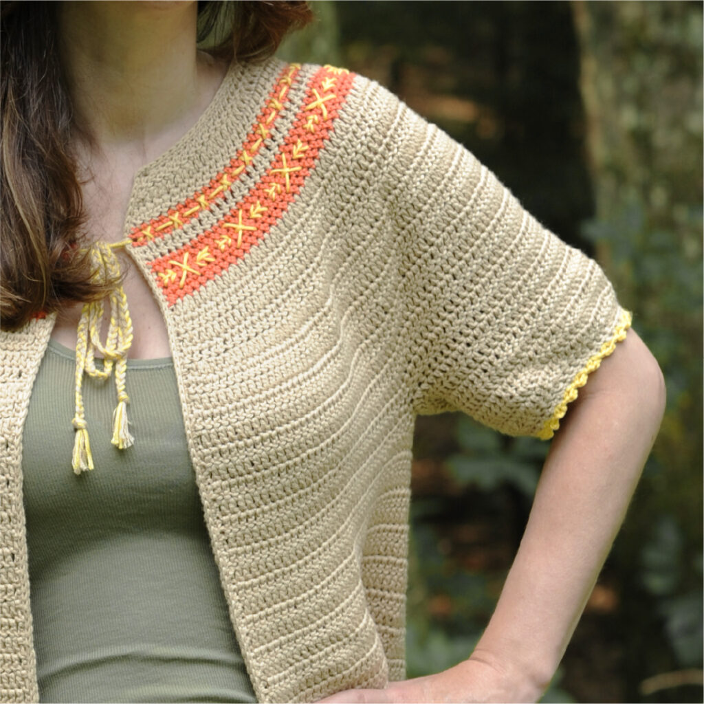 A close up of the short sleeve of the crochet cardigan pattern ideal for summer.