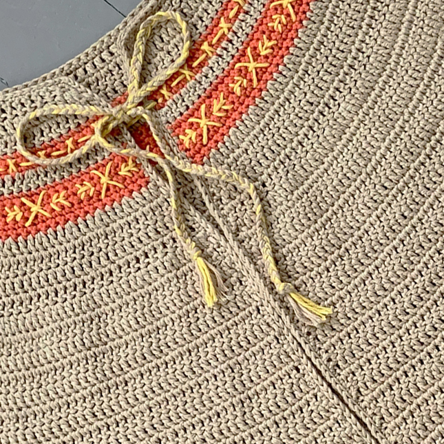 Close up of embroidery on crochet.